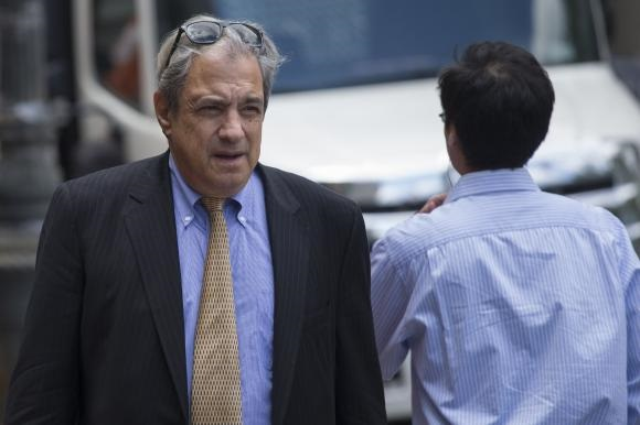 Hedge fund manager Nelson Obus is photographed as he walks into the U.S. District Court in Lower Manhattan, New York